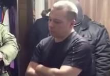 Андрей Злоказов во время обыска. Кадр видео