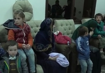 Матери и дети перед отлетом в Чечню. Эль-Камышлы, Сирийский Курдистан. Кадр видео из Инстаграма Рамзана Кадырова