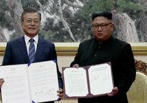 Мун Джэ Ин и Ким Чен Ын. Фото: edition.cnn.com