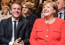 Макрон и Меркель призвали Путина урегулировать конфликт в Донбассе